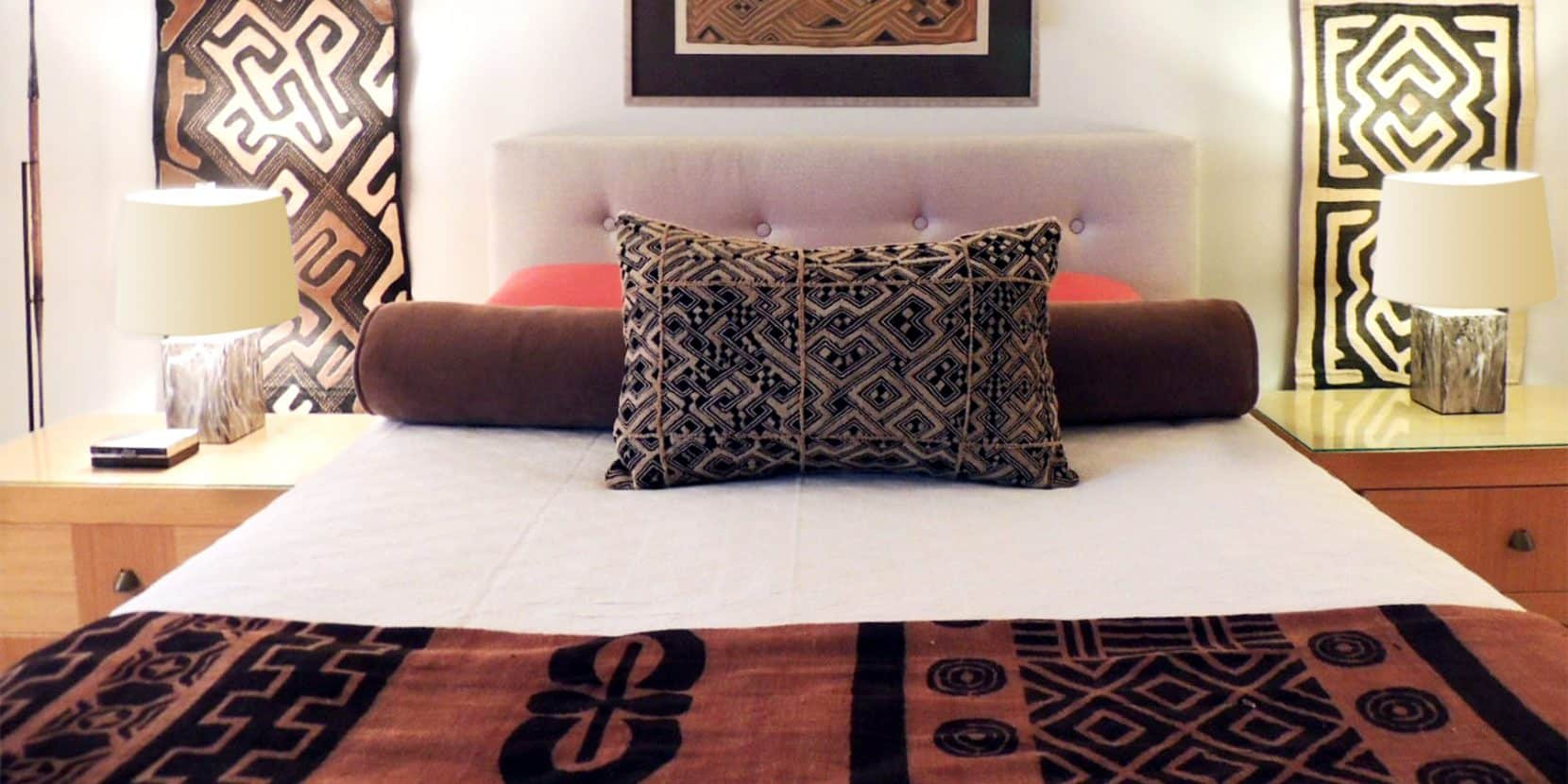 African fabrics in the main bedroom of the apartment Oskar Torres-Lam of Antique Textiles Galleries shares with his husband, writer Jimmy Lam