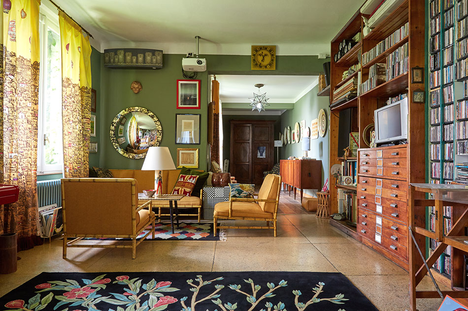 Barnaba Fornasetti's music room with faux-bamboo a sofa and chairs