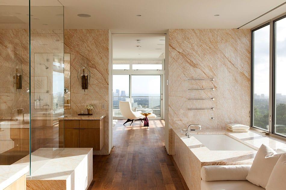 A Summitridge bathroom with windows that overlook the city
