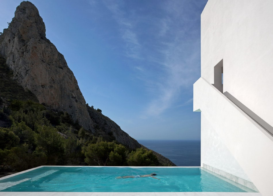 house on a cliff by Diego Opazo