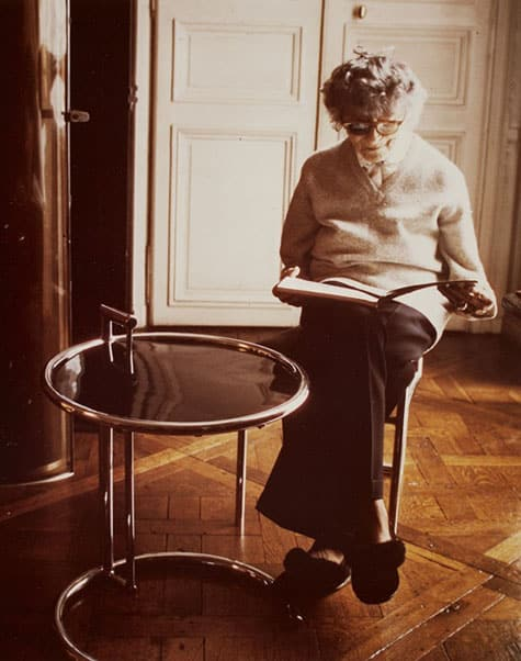Eileen Gray in the 1970s with her E-1027 Adjustable Table