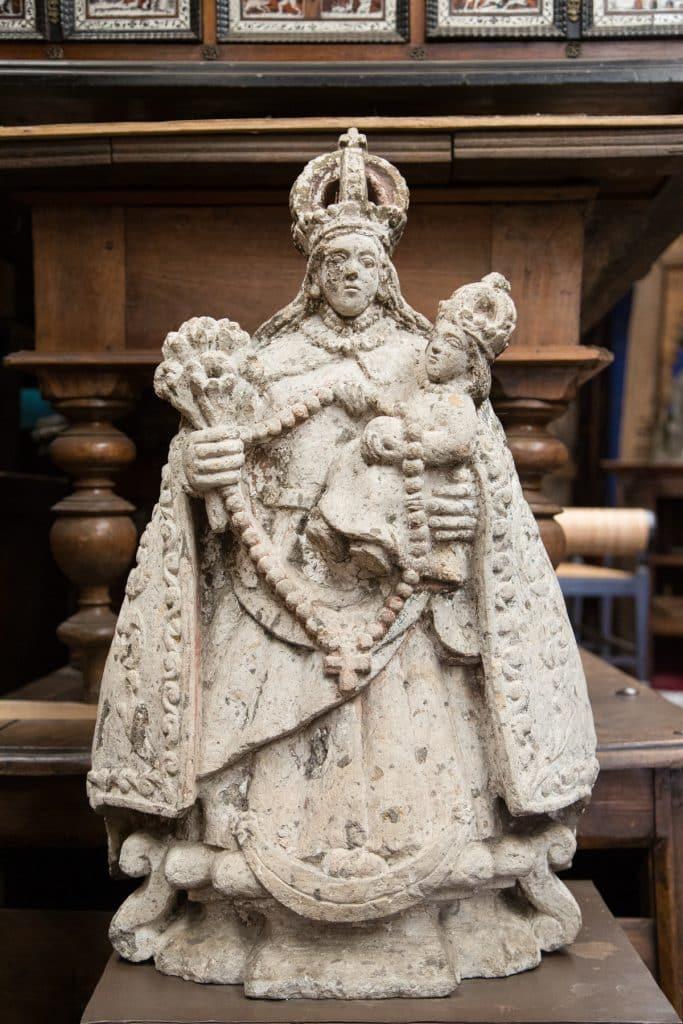 A Mexican stone carving of the Virgin Mary at Rodrigo Rivero Lake's warehouse