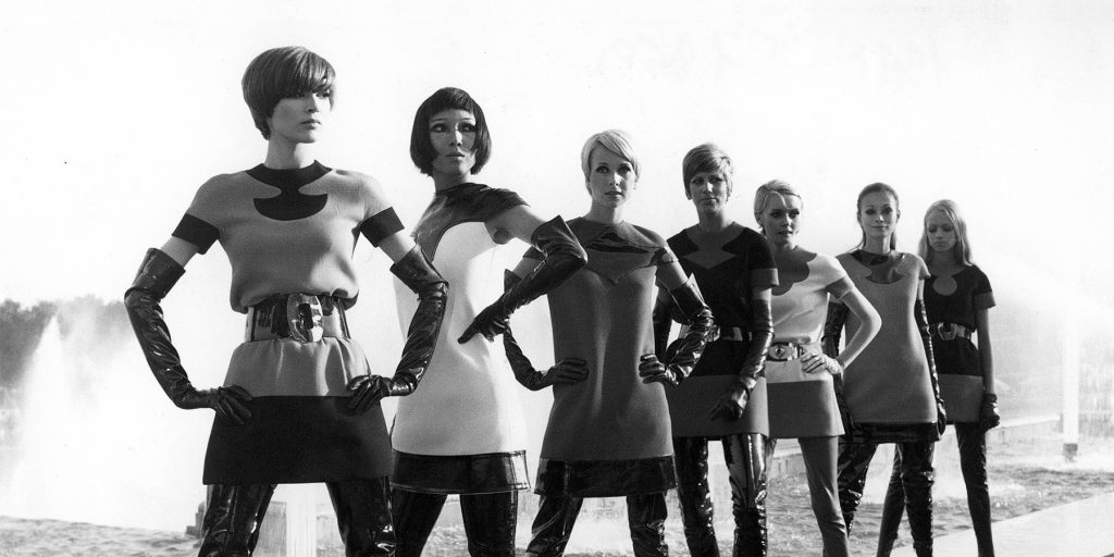 Models wear Cardin's two-tone jersey dresses with vinyl waders in 1969