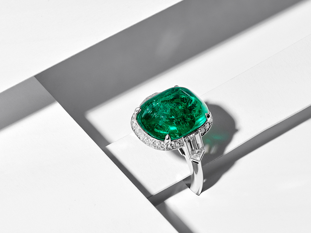 Hancocks 8.59 Carat Sugar loaf Cabochon Colombian Emerald Ring with Diamond Halo