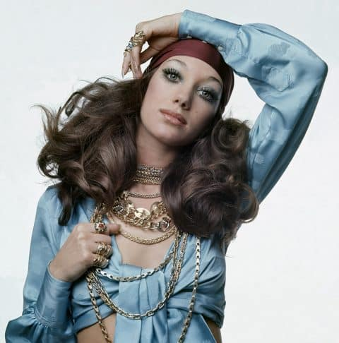 Model Marisa Berenson wears Bulgari chains and rings in Vogue, April 1969