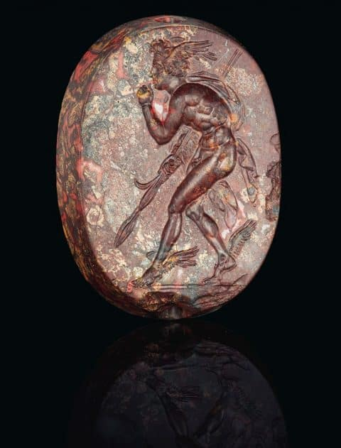 A Greek Mottled Red Jasper Scaraboid with Perseus Classical Period, circa 4th century B.C.