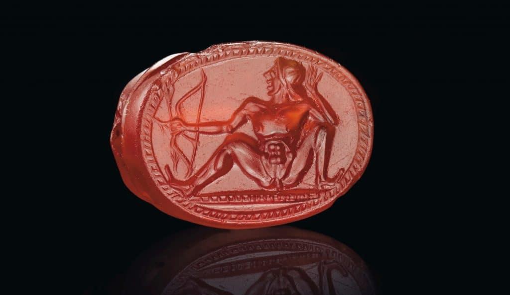 Greek carnelian scarab with a nude archer, ca. early 5th century B.C.