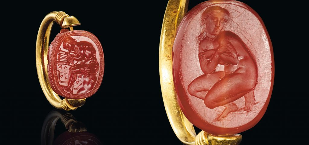 Left: Etruscan gold and carnelian scarab finger ring with Aplu/Apollo, ca. 4th century B.C. Right: Greek gold and carnelian scarab swivel ring with Aphrodite, classical period, ca. 4th century B.C.