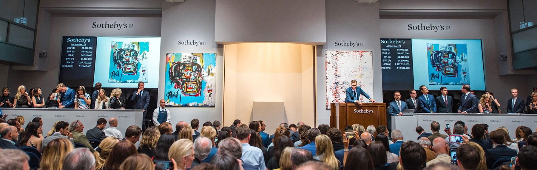 The salesroom at Sotheby's during the auction of an untitled Jean-Michel Basquiat work