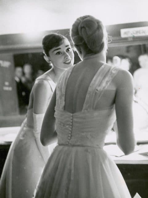 Audrey Hepburn and Grace Kelly backstage at the 1956 Academy Awards