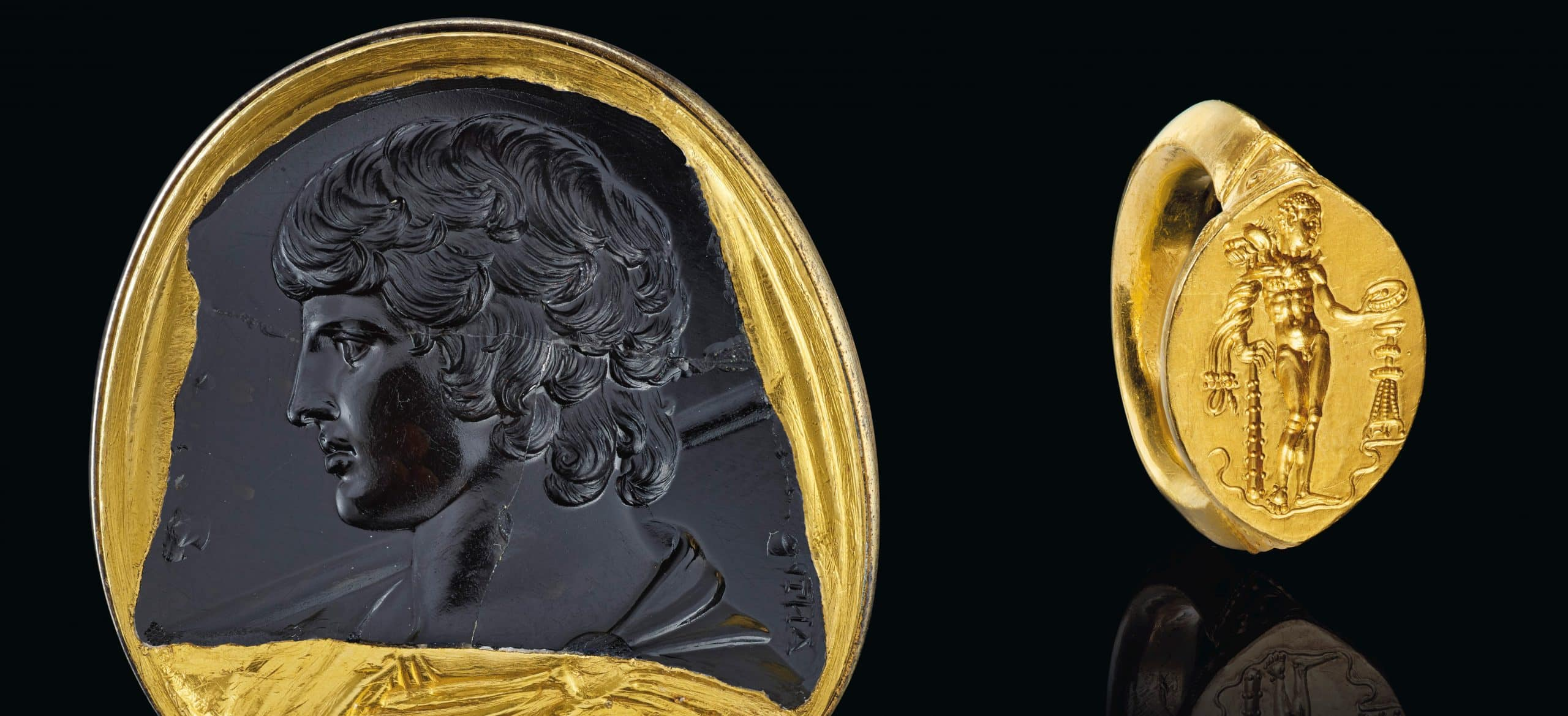 Left: Marlborough Antinous - A Roman black chalcedony intaglio portrait of Antinous, circa 130-138 A.D. Right: Greek gold finger ring with Herakles, classical period, ca. late 5th-early 4th century B.C.