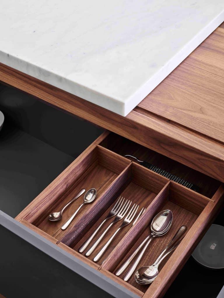 Milan furniture designer Giacomo Moor custom kitchen cutlery drawer sliding cutting board