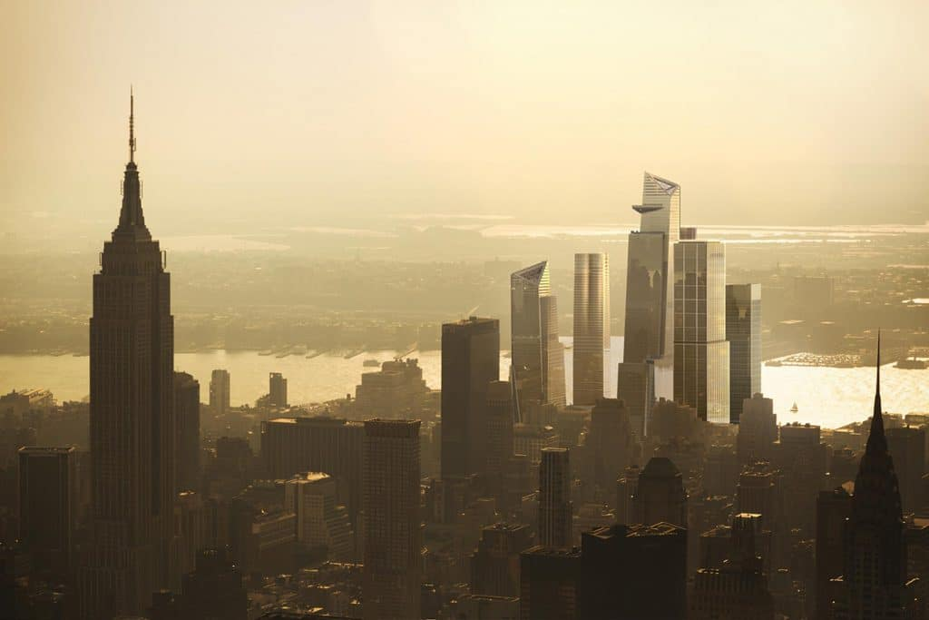 The skyscrapers of Hudson Yards rising in the distance.