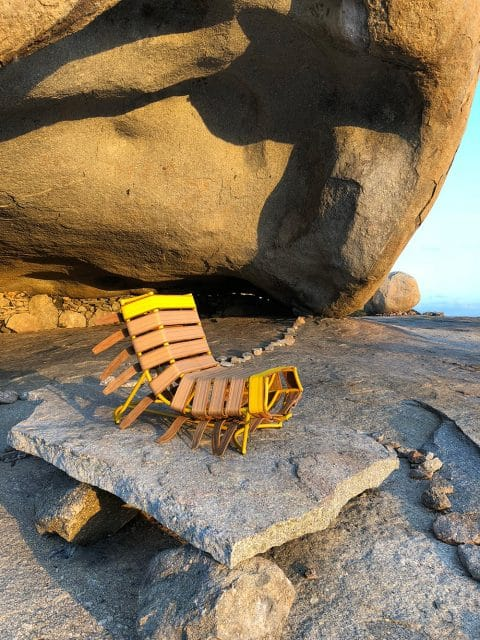 Sergio J. Matos's Arreio chair on a rocky beach