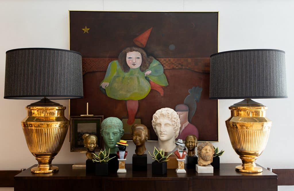 Dragonette credenza with lamps and busts