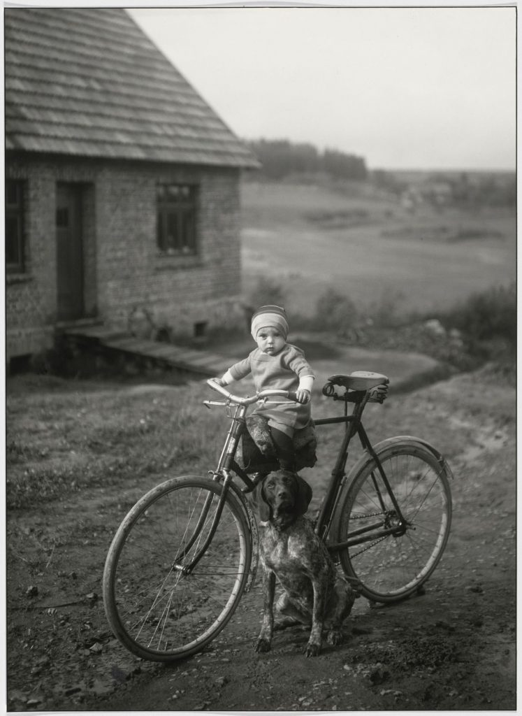 Forrester's Child, Westerwald [Farm Child on Bicycle], 1913, by August Sander