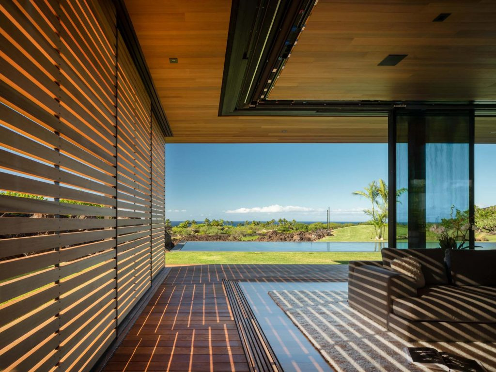 Architect Tom Kundig Olson Kundig Hawaii house Hale Lana living area sliding glass wall shutters