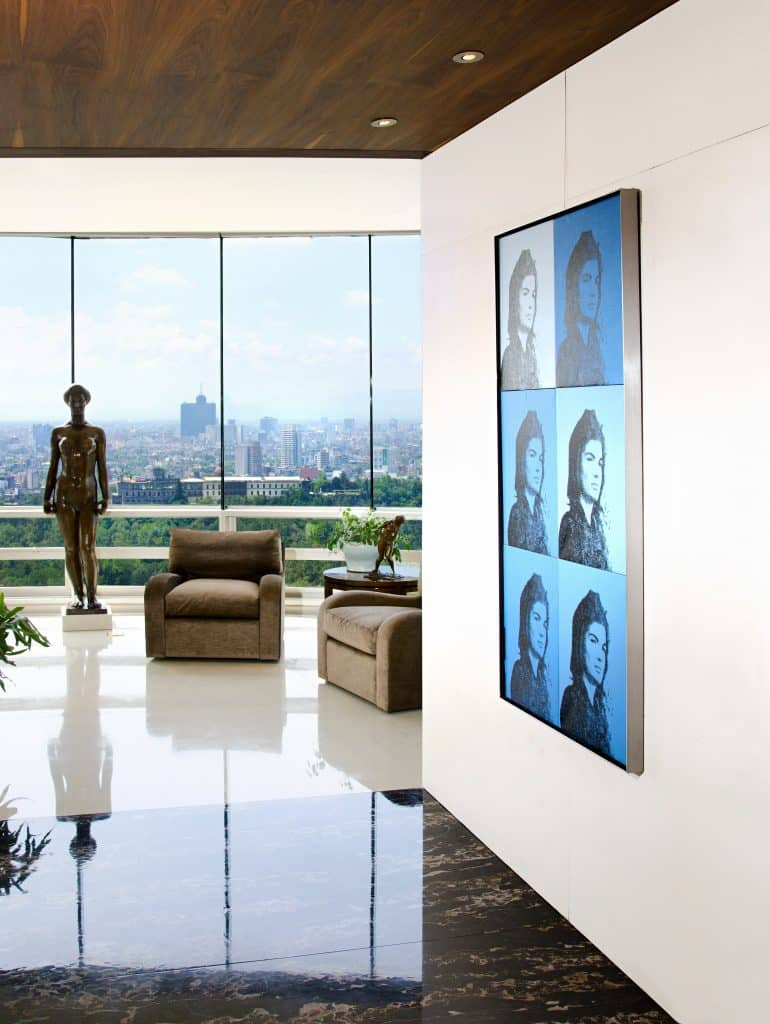 An art collector's Mexico City penthouse by Bradfield & Tobin features a Warhol Jackie painting.