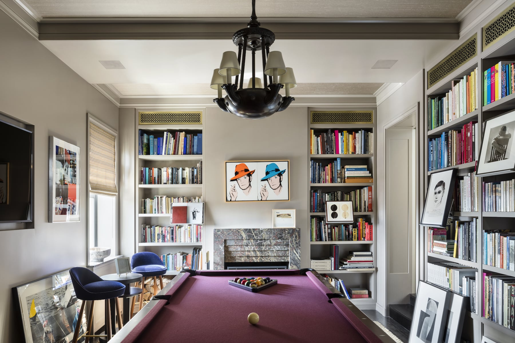 This billiards room designed by Thad Hayes features a Warhol double portrait of Truman Capote over the fireplace.