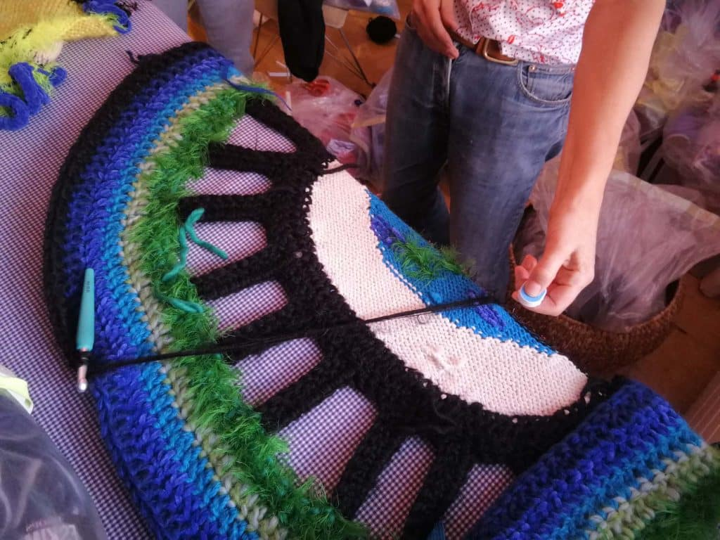 Paris Essex at work on a crochet and knit blanket.