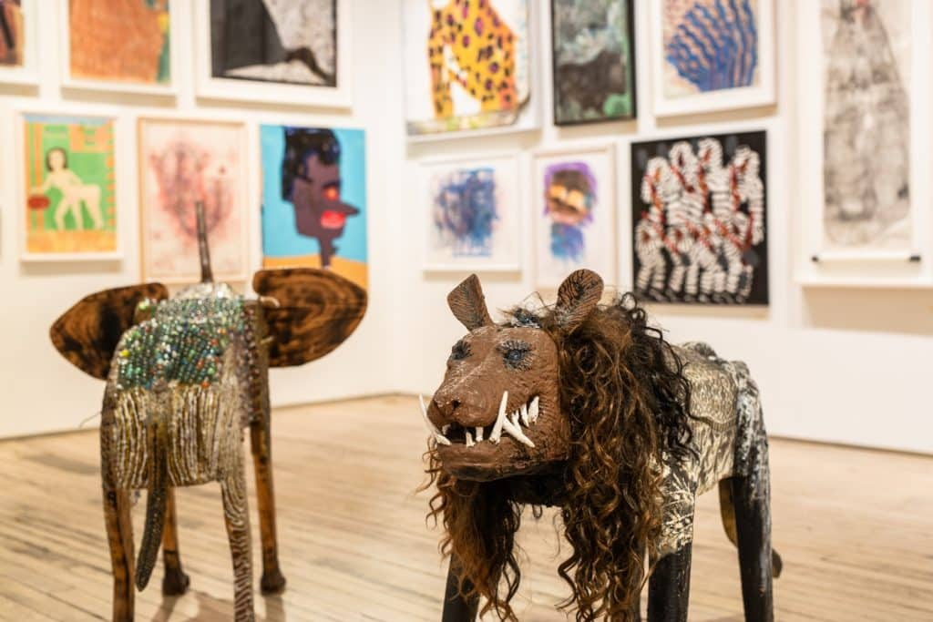 Installation view of a painted-wood elephant and lion by O.L. Samuels at Andrew Edlin Gallery