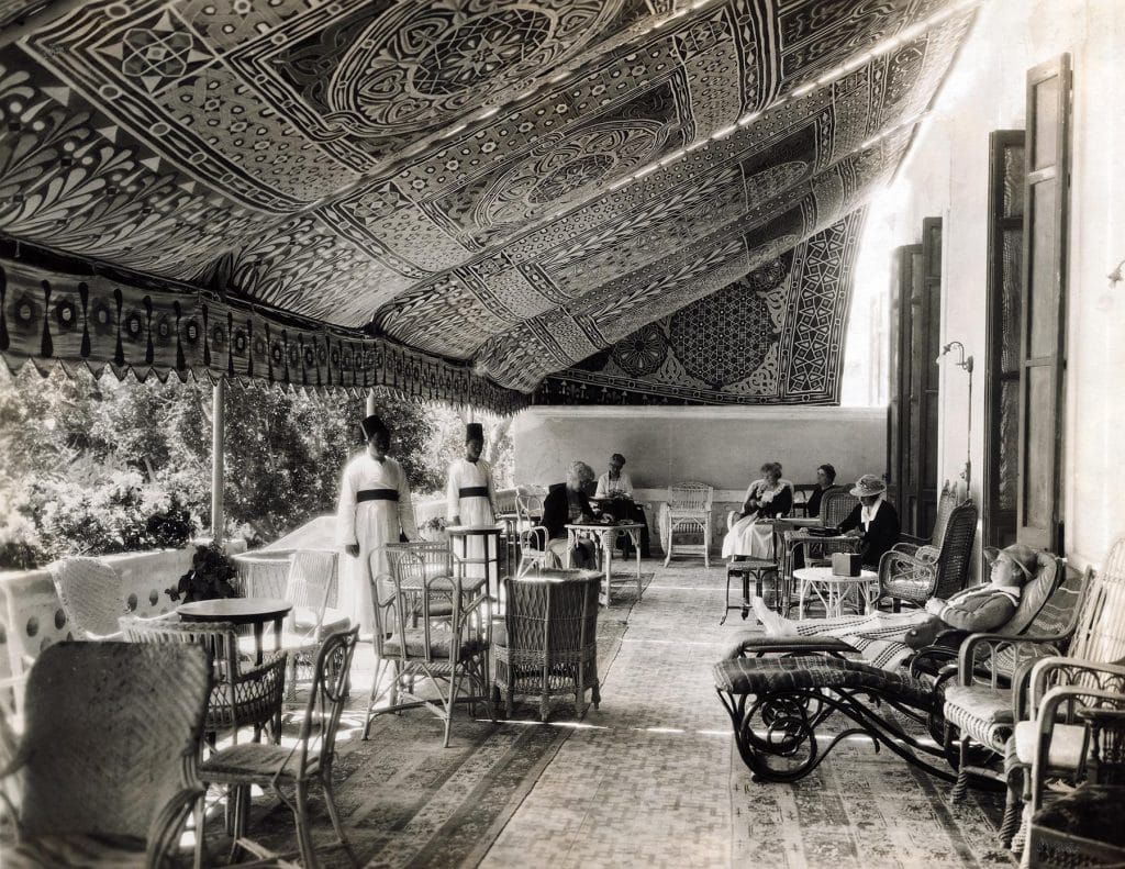 In a black-and-white photo from the book Rattan: A World of Elegance and Charm, by Lulu Lytle, published by Rizzoli, rattan furniture fills the veranda of the Helouhan Hotel, near Cairo