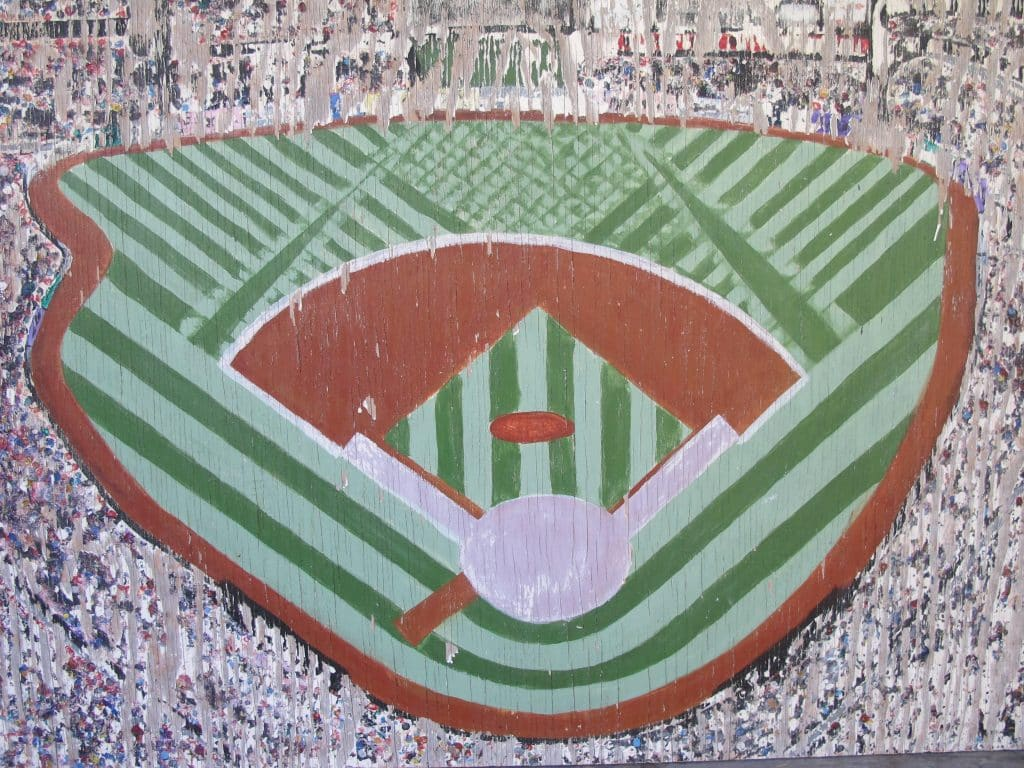 A detail from a wood-panel painting of the city of St. Louis with an abstract depiction of Busch Stadium, offered by American Primitive Gallery