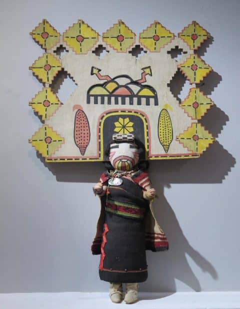 An oversize Hopi Butterfly Maiden kachina figure with a cut-wood headdress and a turquoise and abalone-shell necklace. offered by American Primitive Gallery