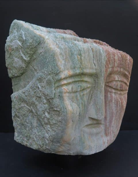 A stone head carved by Ted Ludwiczak in 2004, offered by American Primitive Gallery