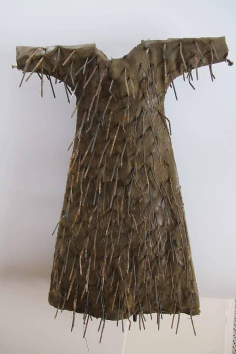 A 2013 dress decorated with iron nails by Larry Calkins, offered by American Primitive Gallery
