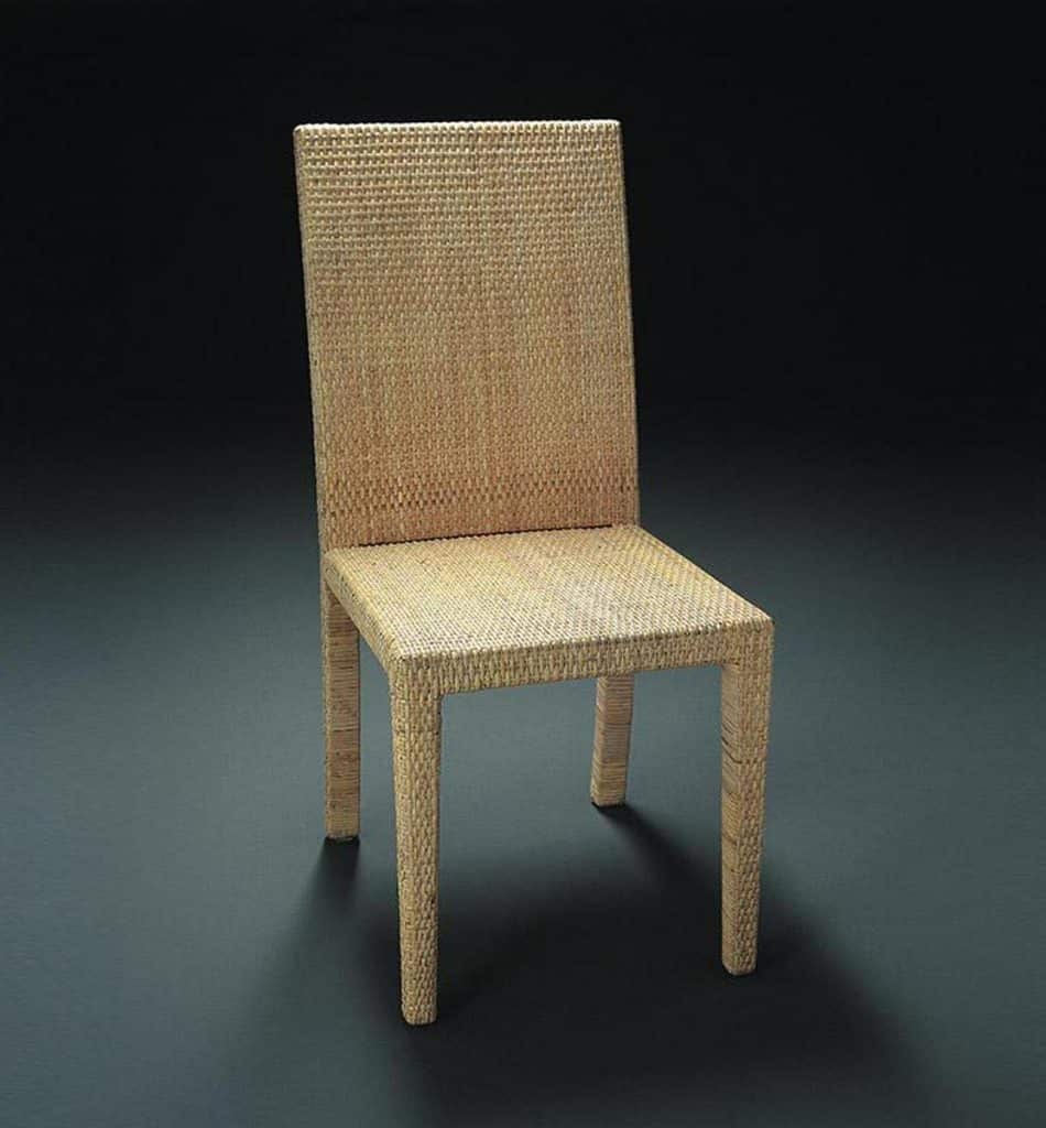 A woven rattan chair by Jean-Michel Frank and Adolphe Chanaux for Ecart from Majdeltier