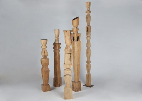 A collection of wooden totems by Franck Evennou