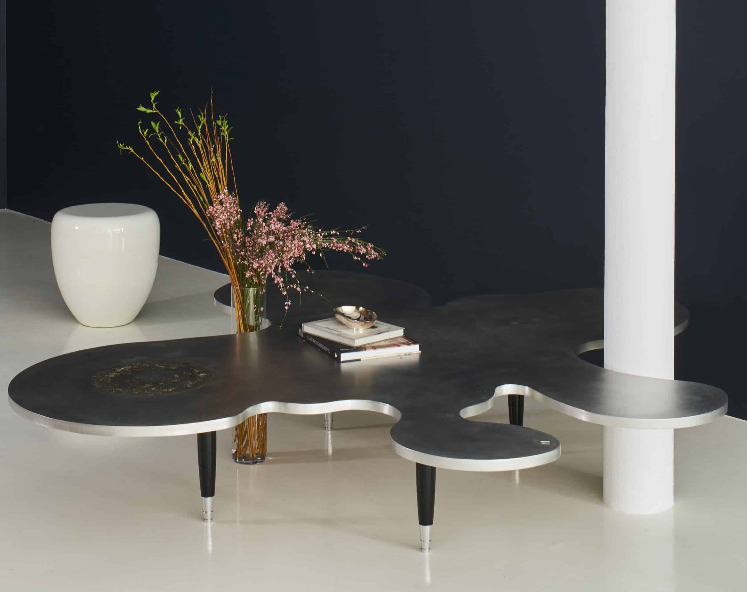 """Lavergne's Meteors """"Splash"""" coffee table is made of wood wrapped with pewter"""