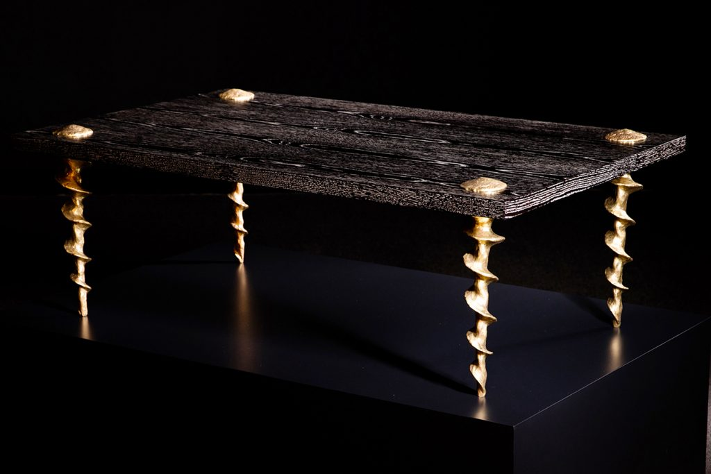 A Franck Evennou oak-and-bronze coffee table with screw-shaped legs