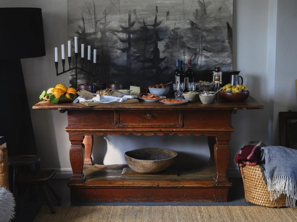 An early 18th-century Swedish baroque table from D.Larsson topped with a traditional Christmas meal known as Julbord.