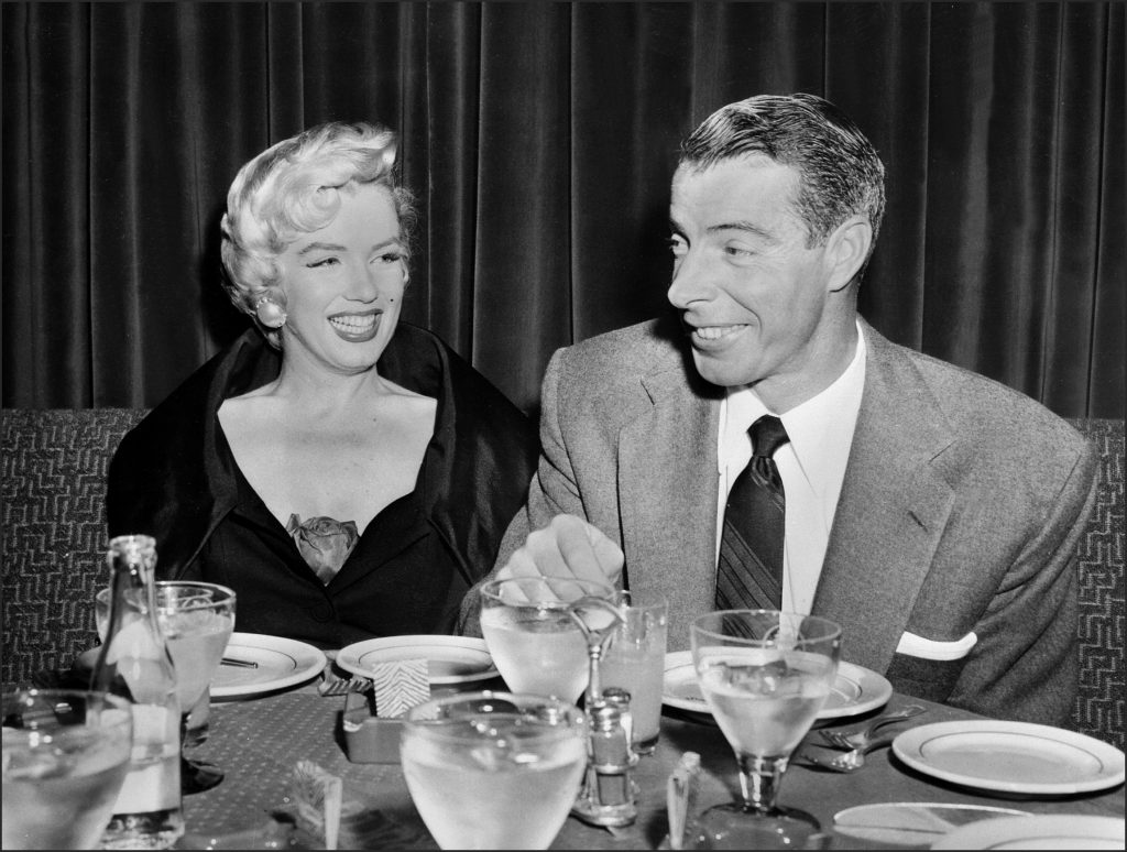 Screen legend Marilyn Monroe and baseball great Joe DiMaggio seated at a table in San Francisco in the 1950s