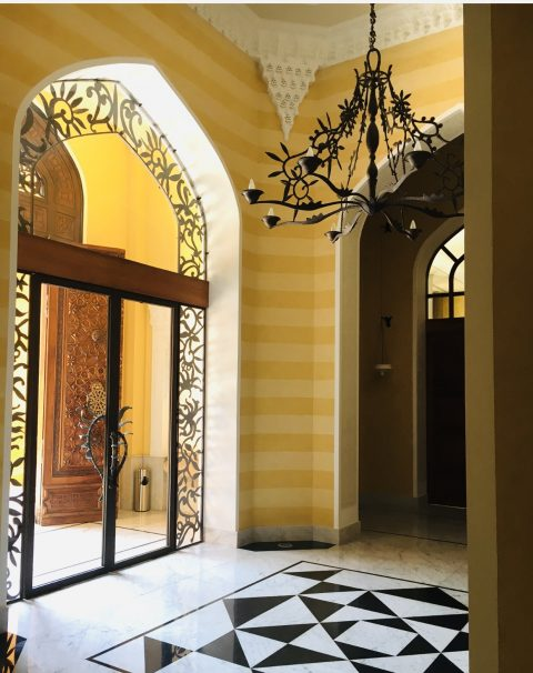 A bronze doorway and chandelier by Franck Evennou adorn the French ambassador's residence in Beirut
