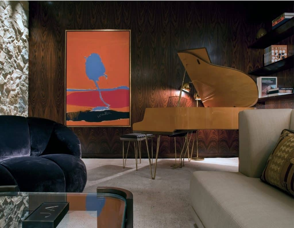 Robert Motherwell's 1963 canvas A Throw of Dice, # 17 next to a 1960s German piano in Jennifer Aniston's home in Beverly Hills, designed by Stephen Shadley