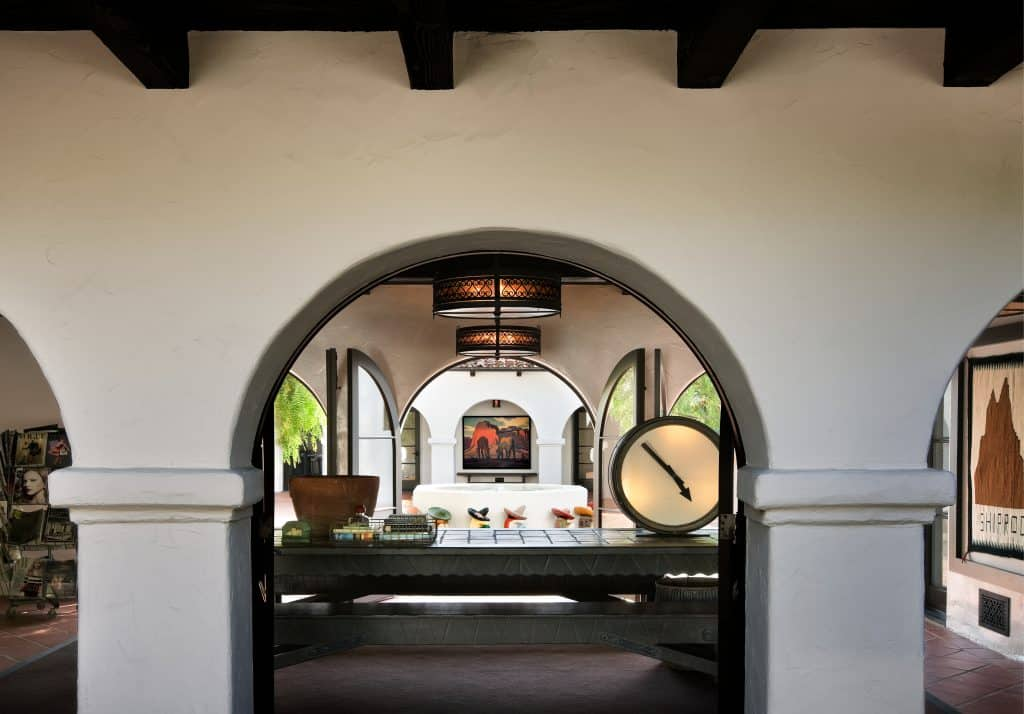 Loggias with repeating arches surround the courtyard of Diane Keaton's former residence in Beverly Hills, designed by Stephen Shadley