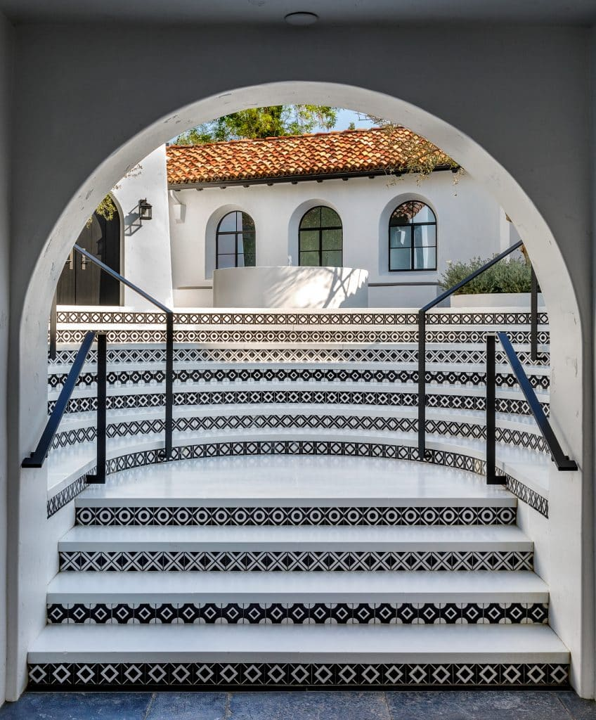 Black-and-white-tiled steps at producer Ryan Murphy's Spanish-style home in Pacific Palisades, designed by Stephen Shadley