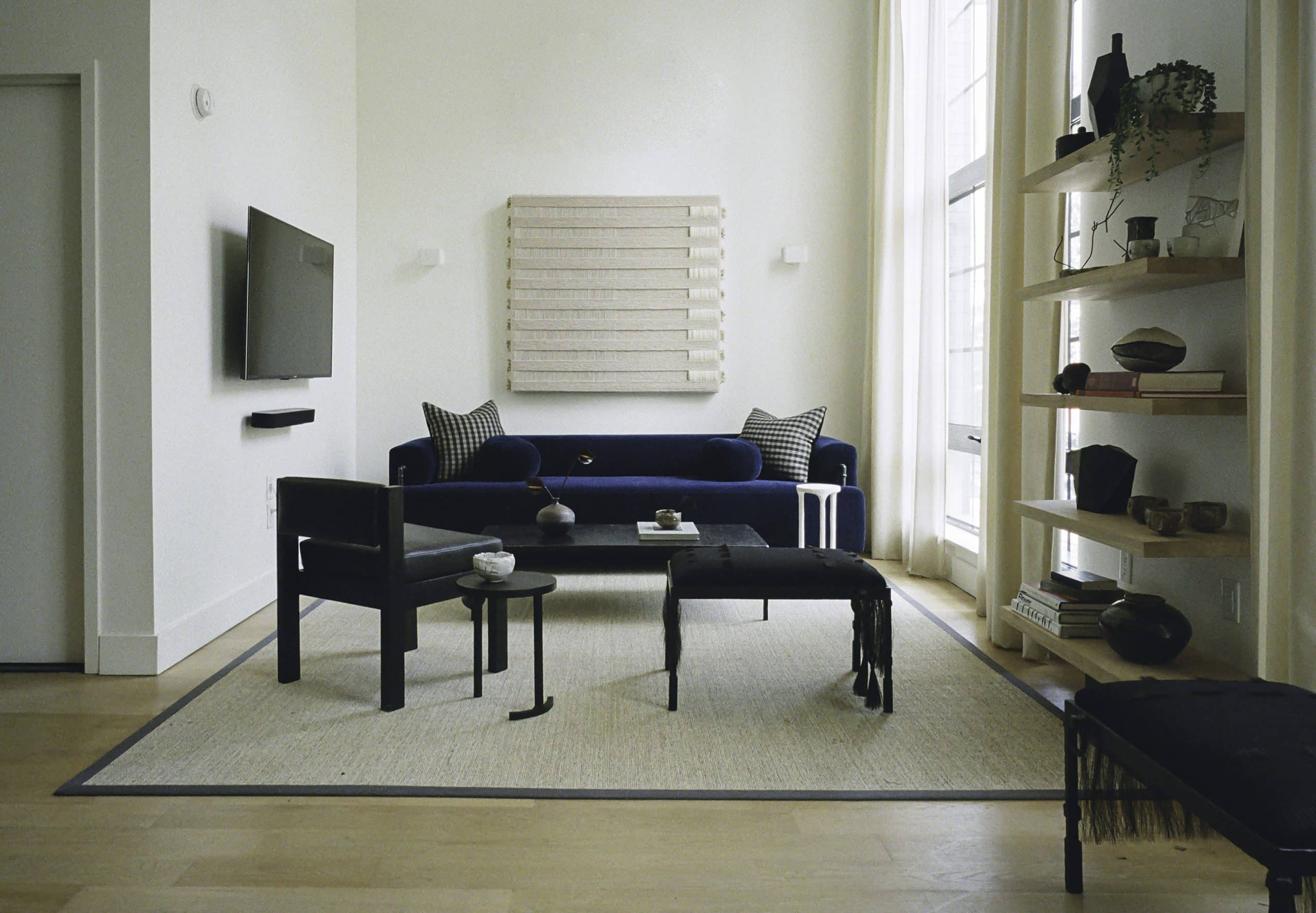 Szymanski designed the benches, tables and mohair sofa in the living room.