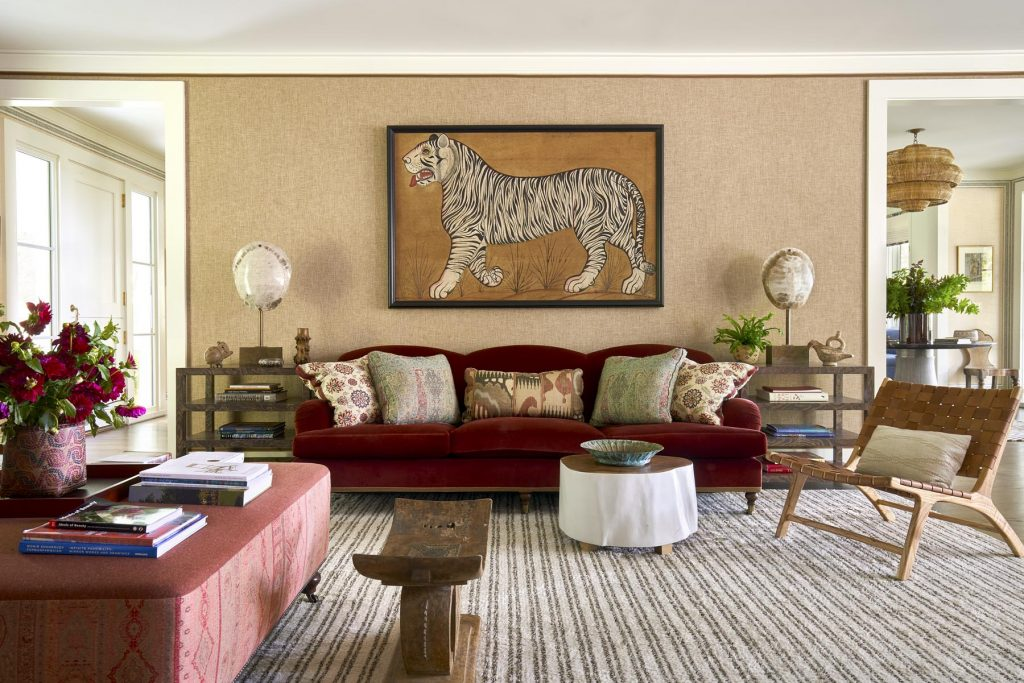 An Indian painting of a white tiger above the couch in the living room of a Millbrook, New York, farmhouse, from the book Markham Roberts: Notes on Decorating