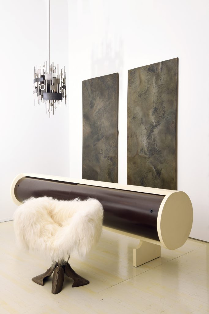 """An Alain Douillard pendant, a pair of wall panels by Pierre Sabatier, a Jean-Louis Chanéac sideboard and a 1970s or '80s goatskin chair at Magen H Gallery's 2019 show """"50 Years of French Design"""""""