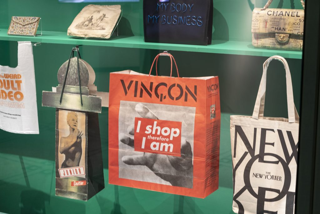 "A display of bags with text and slogans in the exhibition ""Bags: Inside Out,"" at London's Victoria and Albert Museum"
