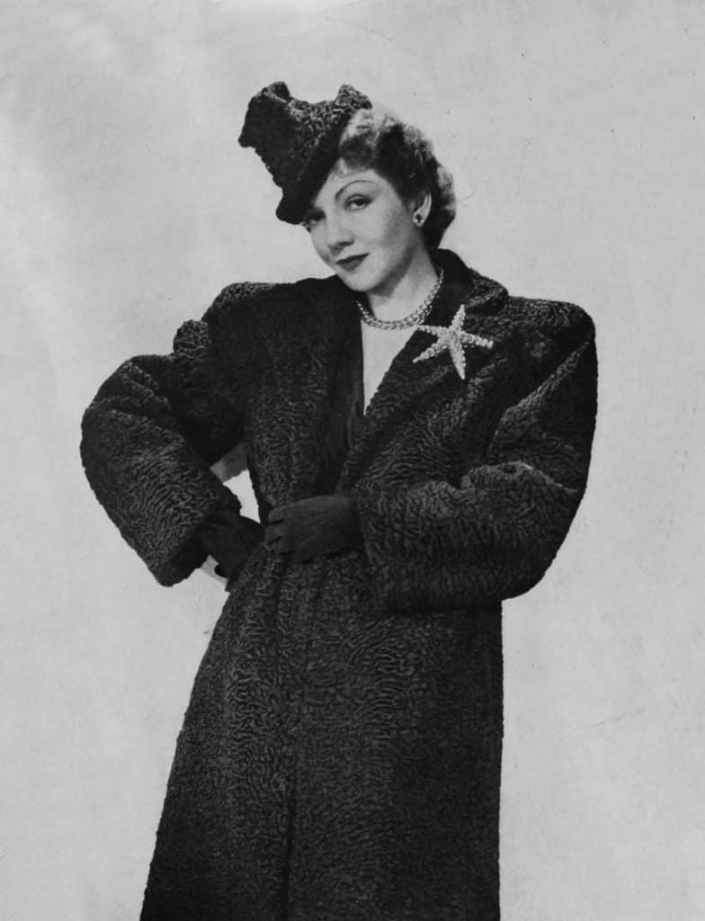 Claudette Colbert wearing a René Boivin starfish brooch later sold by Siegelson