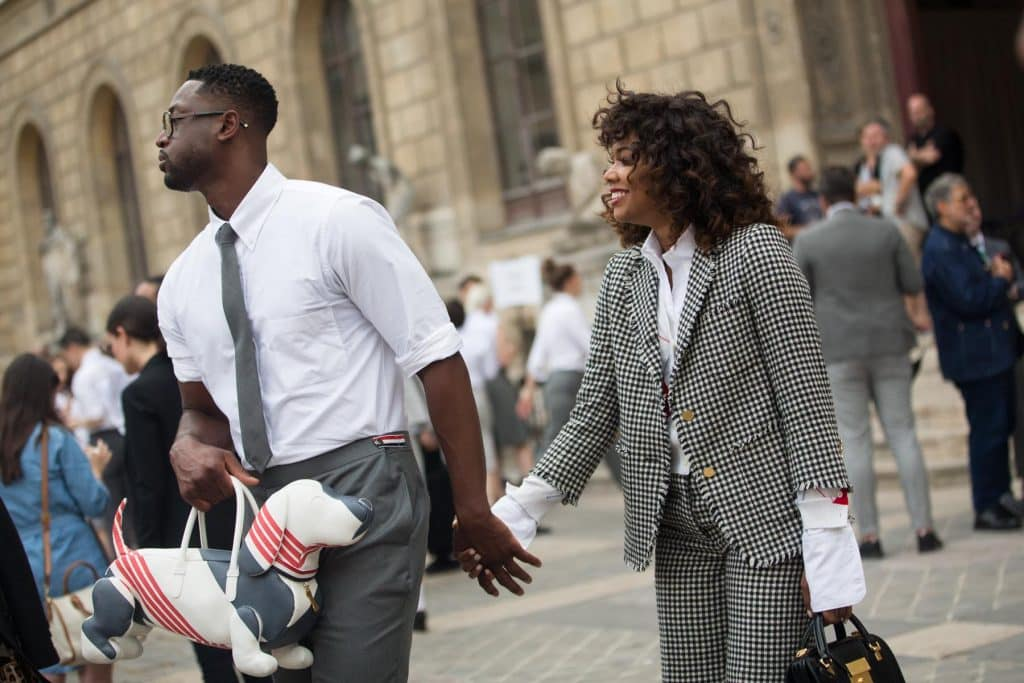 Dwyane Wade, hand in hand with Gabrielle Union, carries Thom Browne's Hector bag outside the designer's Paris runway show in 2017.