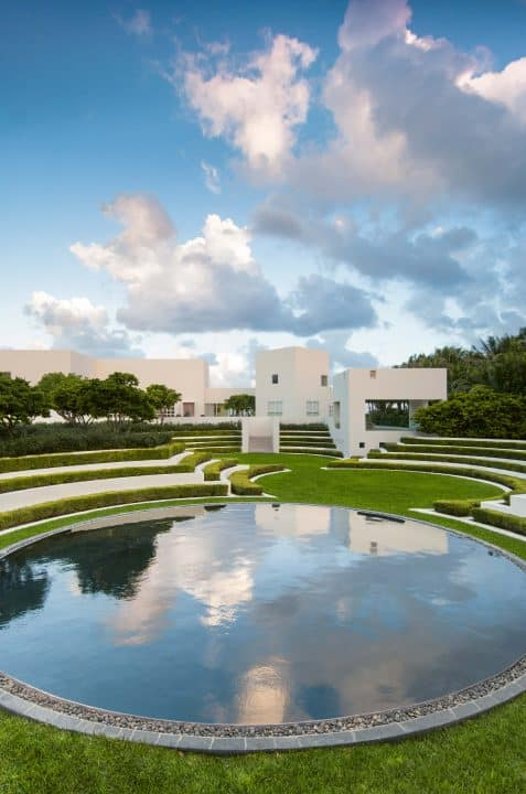 The circular pool and curved tiers of yaupon in Fernando Caruncho's Flynn project, near Boca Raton, Florida