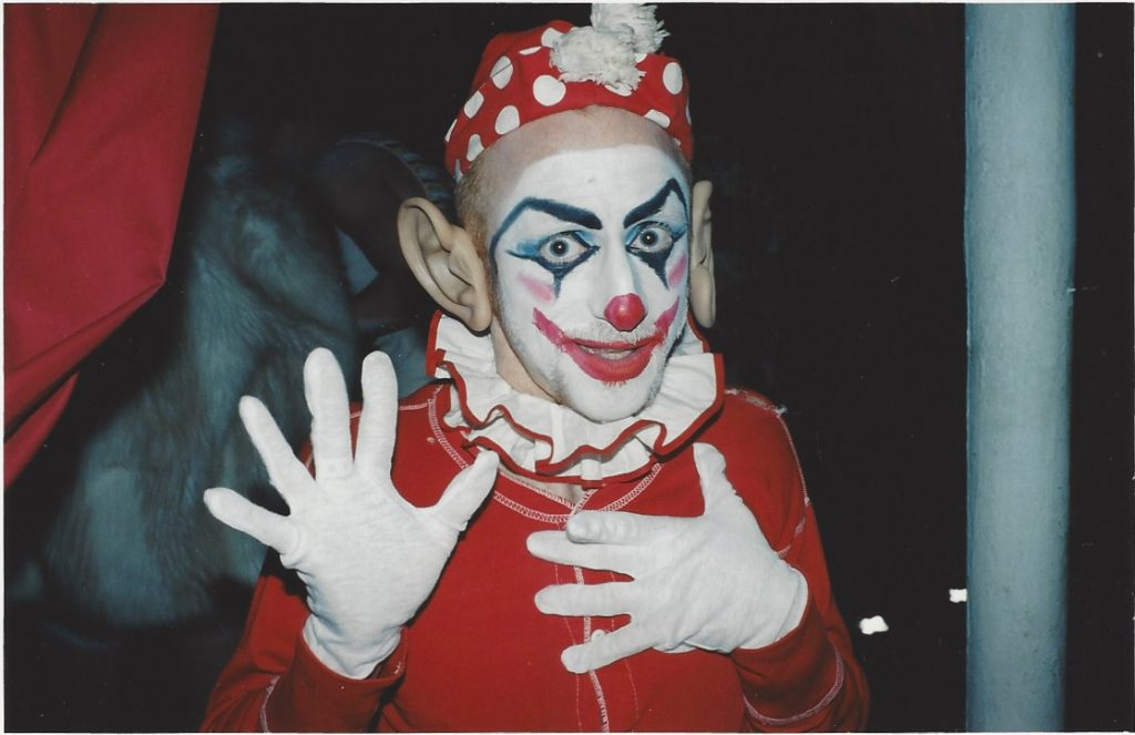 """A performance artist dressed as a clown at the exhibition """"Ways & Means Committee"""" at Ivy Brown Gallery"""