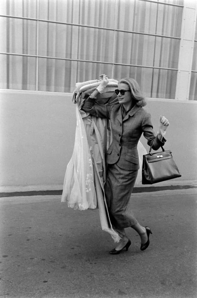 "Grace Kelly runs errands in Hollywood with her eponymous Hermès handbag, one of the many carryalls discussed in the exhibition ""Bags: Inside Out,"" at London's Victoria and Albert Museum"