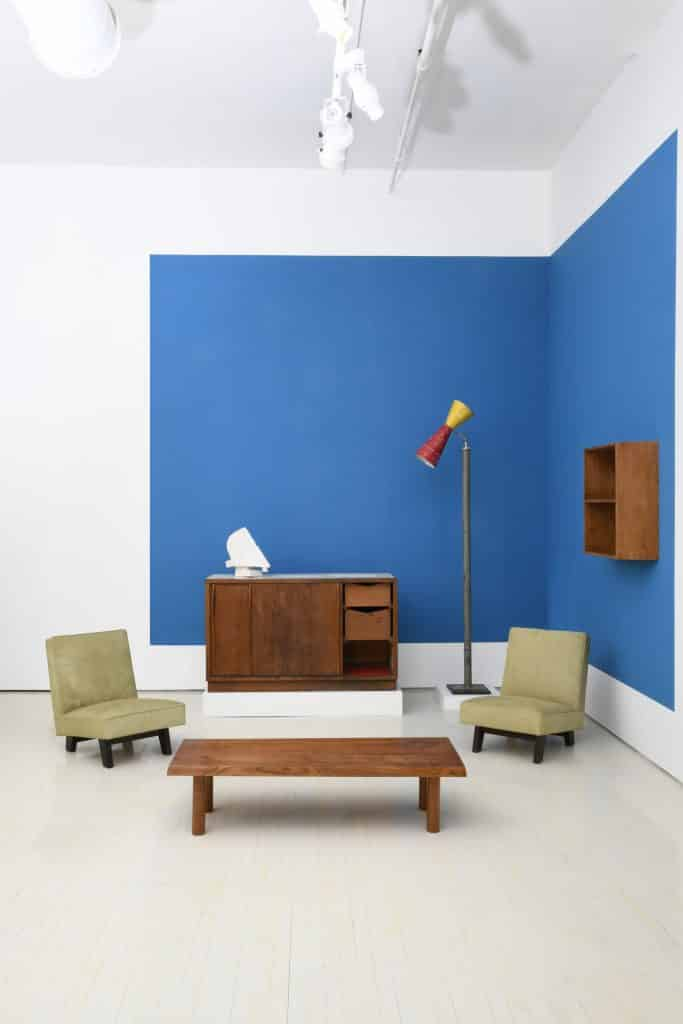 A Le Corbusier floor lamp, a wall shelf by Le Corbusier and Charlotte Perriand and a pair of chairs by Le Corbusier, Pierre Jeanneret and Jeet Lal Malhotra at Magen H Gallery
